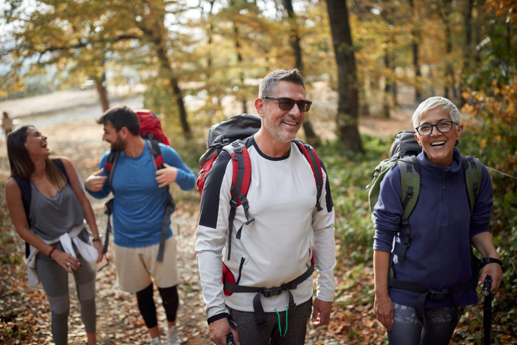 Family trekking in the woods; Quality family time concept
